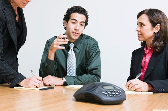 workers on speakerphone
