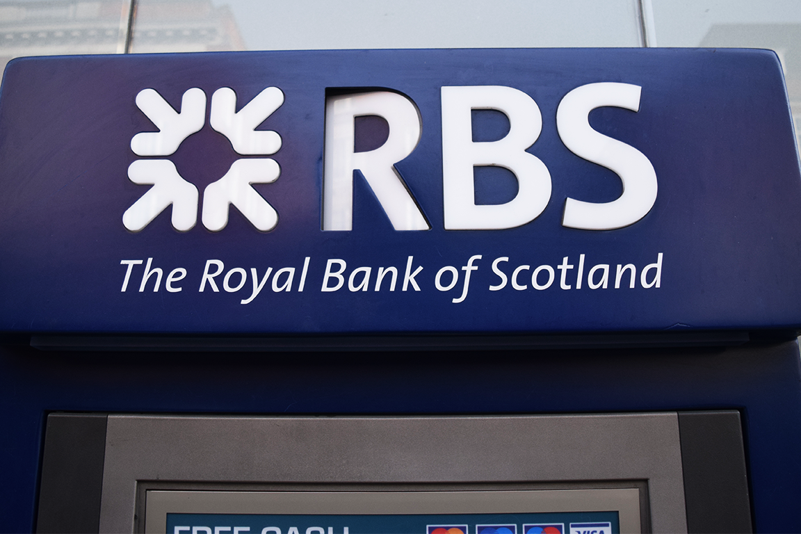 royal bank of scotland stock gains as it swings into profit