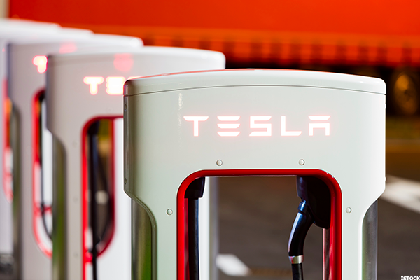 Tesla is doubling the size of its charging network