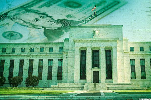 Up as Fed raises rates but stays course