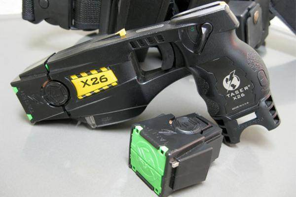 Taser changes name in shift to software, police services""