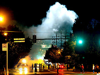 riots unrest in ferguson mo spread over police shooting of