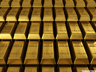 Gold Prices Fall as Dollar Strengthens (Update 1)