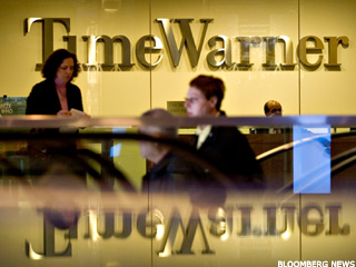 9 Earnings Profiles: Humana, Merck, Time Warner