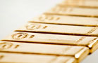 Gold Prices Dip as Dollar Strengthens (Update 1)