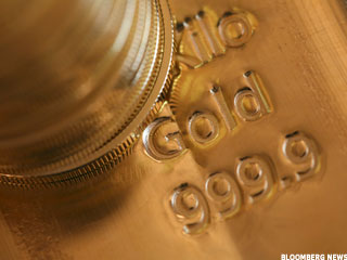 Gold Erases Gains, Dips on Fed Minutes (Update1)