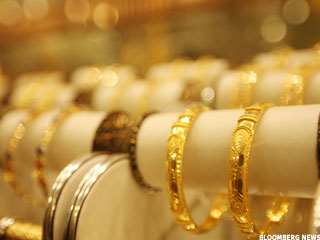 Gold Prices Sink as China Inflation Jumps (Update 1)