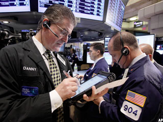 Dow Closes Above 12,000 as Greece Drops Bailout Vote