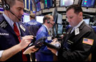Stocks Close Mixed on Greece Bailout Questions