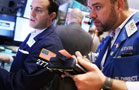 Stock Futures Slide on Cautious Fed, Growth Outlook