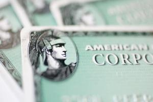 Midday Report: AmEx Leads Dow After Dividend Hike; U.S. Stocks Climb