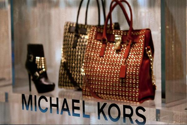 Closing Bell: Michael Kors Spikes on Deal Speculation; Oil Ends at Best Since July 2015