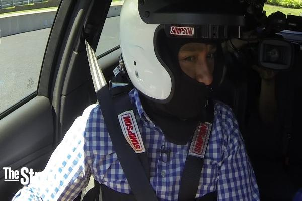 Race Car Driver Ben Collins Takes TheStreet on a Nail-Biting Course