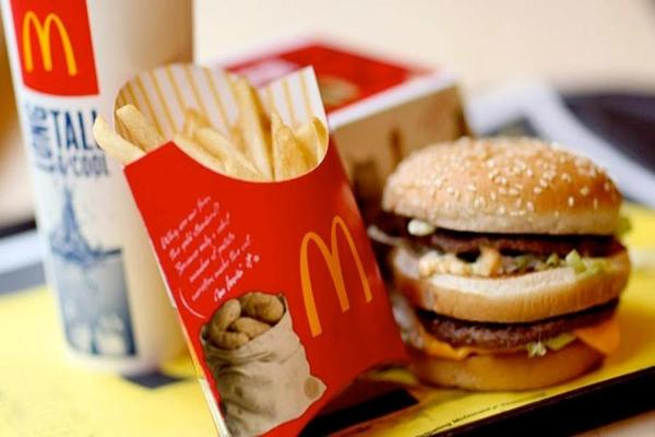 McDonald's, Caterpillar Drive Triple-Digit Dow Gains; Alphabet Sinks