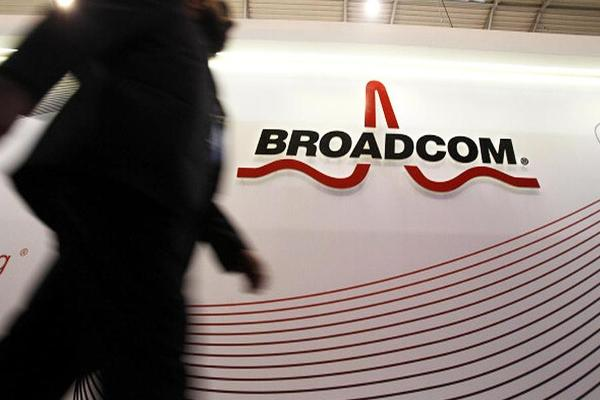 Midday Report: Broadcom Swings to a Profit; U.S. Stocks Trade Above Closing Records