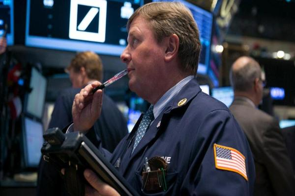 Closing Bell: Guess? Sinks After Cutting Profit Target; Dow Ends at Record