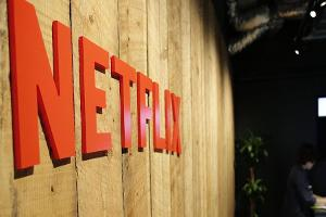 Midday Report: Netflix at Records on High Hopes for International Profits; Wall Street Rises