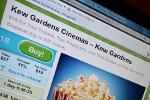 Groupon, Cablevision Downgraded