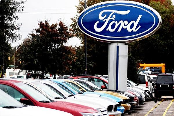 Closing Bell: Ford Announces Recall Over Seatbelt Issue; Dow Retreats From Records