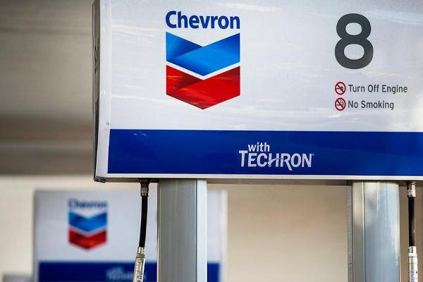 Closing Bell: Chevron Weighs on Dow After Crude Crash; U.S. Stocks Higher