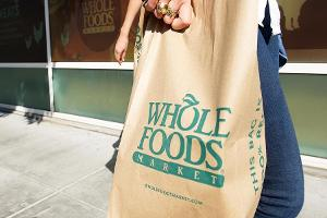 Closing Bell: Whole Foods Spikes on Deal Speculation; Nasdaq Sets New Record