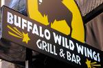 Closing Bell: Buffalo Wild Wings CEO to Step Down; Wall Street Clinches New Records