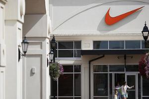 Midday Report: Nike Weighs on Dow on Disappointing Outlook; Crude Oil Slumps