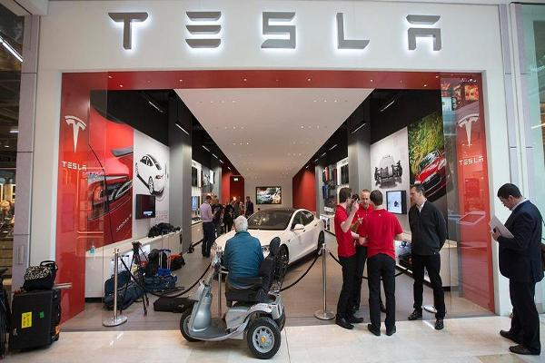 Closing Bell: Tesla Unveils New Models; Crude Oil's Surprise Rally