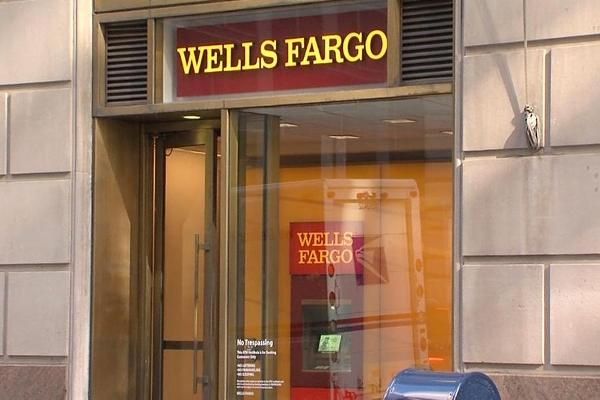 Closing Bell: Wells Fargo Fires Managers; Wall Street Ends at Fresh Records