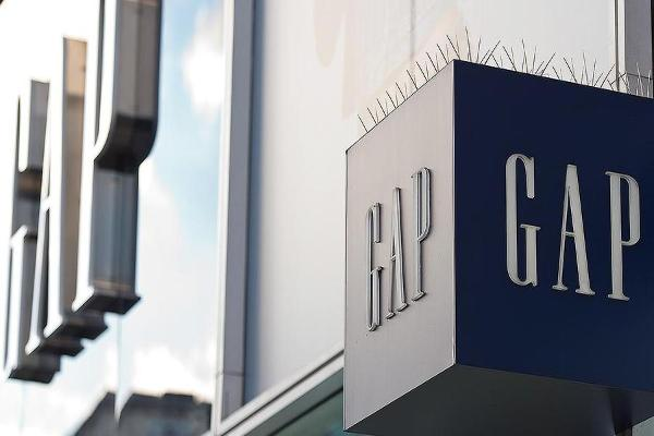 Midday Report: Gap Enjoys Positive Holiday Season; Stocks Make Shaky Gains