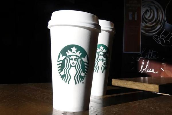 Midday Report: Starbucks' Disappointing Growth; U.S. Economy Slows in Fourth Quarter