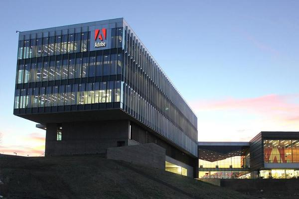 Midday Report: Adobe Sees Sunny Fourth Quarter; U.S. Stocks Fall