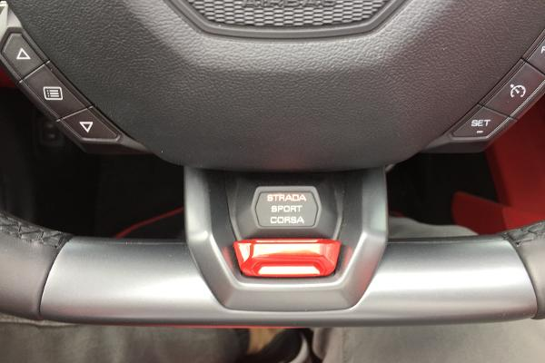 "Buttons that let you change the drive mode. The Italian is a nice touch. Flip on ""sport"" and hear the Lambo growl."