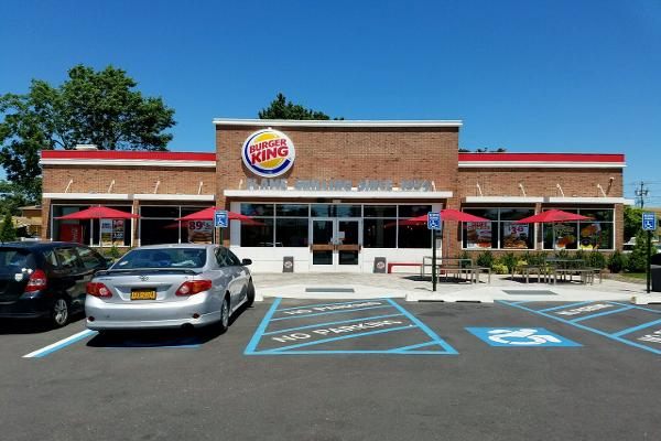 Is that outdoor seating we see underneath a giant banner calling attention to Burger King's heritage?!
