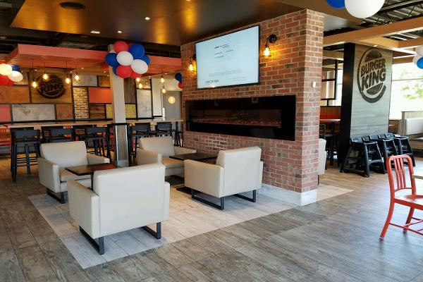 Faux fireplace, large flat screen TV playing local news and more comfy seats.