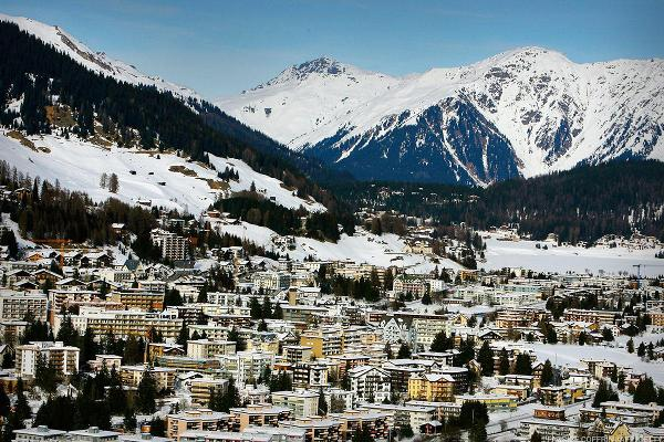The Week Ahead: Davos, Impeachment, PMI and 25 Key Earnings Reports to Watch