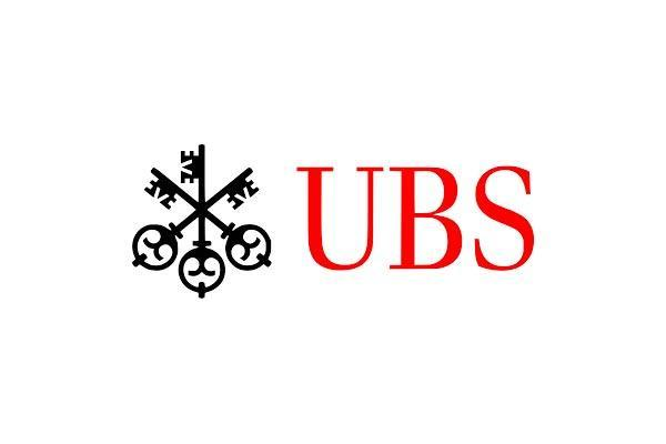 UBS Warns on Outlook as Net Falls After Charges