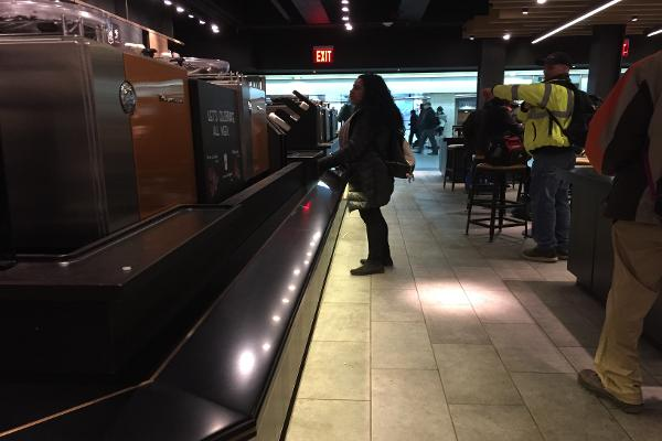 An extra-long counter to wait for drinks and food alleviates typical Starbucks crowds.