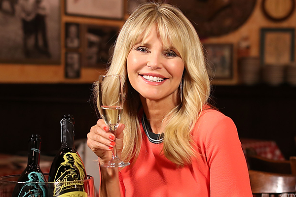 Christie Brinkley toasting with her prosecco, Bellissima.