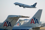 American, Delta Shares Lower After Deutsche Bank Analyst Downgrades
