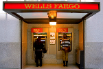 Wells Fargo Closes Lower in Wake of Network Outages