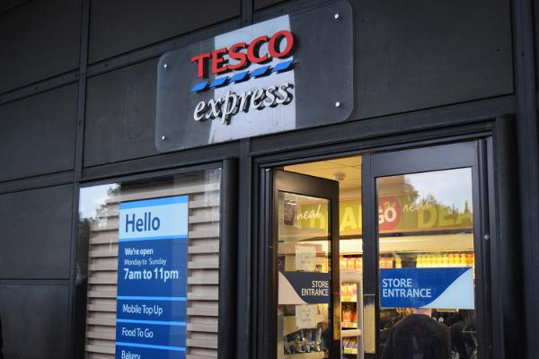Tesco Slumps As Booker Deal and Fines Overshadow Positive Earnings