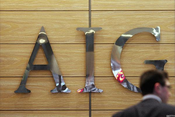 AIG Falls Following Rating Downgrade
