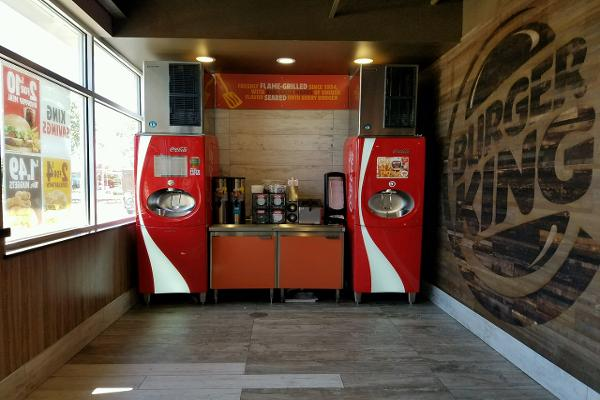 Digital soda machines and more wood on the walls.