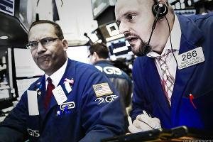 Dow Dives Sharply on Rates Fears, Tech Shares Sink Nasdaq