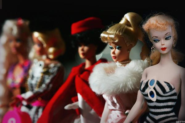 The first Barbie doll from 1958 (right) and Barbie through the years