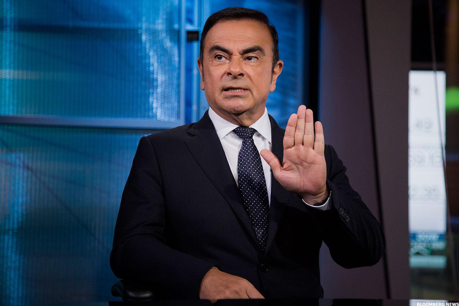 Carlos Ghosn Grabs Renault Steering Wheel Amid Massive