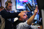 Dow Finishes Lower as Nasdaq Posts New Record