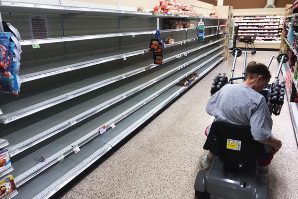 Publix Supermarket was sold out of bottled water and its bread stock was nearly cleared.