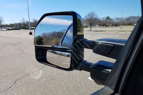 A big truck requires more mirrors to see as much as possible.